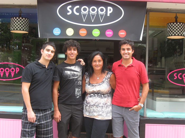 Copyright LIHerald.com Diane Angelis and her husband, John (not pictured), opened an ice cream shop named Scooop in Malverne. Their three sons, from left, Nicholas, Alexander and Evan, take turns working shifts.