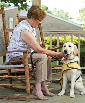 Copyright Long Island Pulse Magazine Puppy raiser Susan Semple and Max, who is undergoing training to become a guide dog.